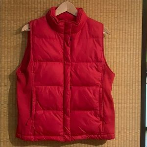 Down filled vest with rib side panel